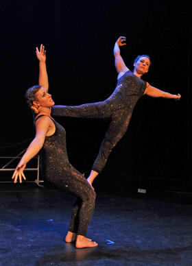 "Amy Longcrier, left, and Kelly Marburger, right, during a performance of ""Cirque du Charme"" at Baltimore Theater Project during Artscape. The performers are from Charm City Movement Arts, an independent circus school based in Highlandtown."