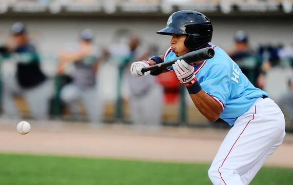 The IronPigs' Cesar Hernandez lays down a bunt in the win over Columbus at Coca-Cola Park in Allentown on Sunday.