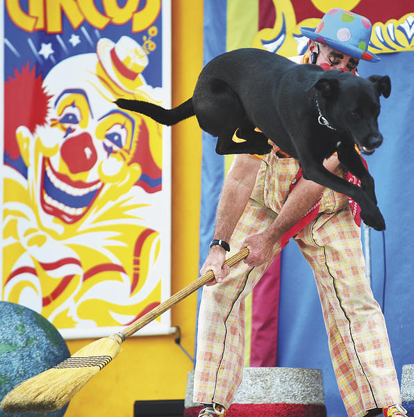 Robert Bone of the Skin and Bones' Comedy Circus performs with Tootsie-Roll on Sunday for an audience at the Washington County Ag Expo & Fair.