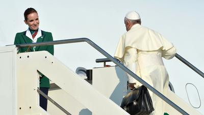 Pope Francis dispenses with formalities on first overseas trip