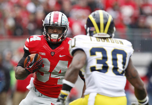 Ohio State running back Carlos Hyde tried to avoid Michigan Wolverines safety Thomas Gordon in a game last season.