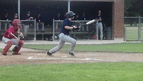 Joey Hoffman singles for New Trier in state-tournament action against Maine South.