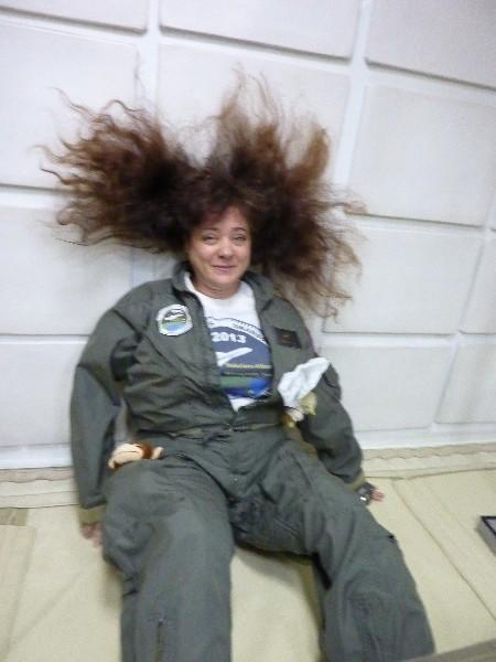 Lisa Saunders, of Poinciana Elementary in Boynton Beach lets her hair loose as she experiences zero gravity aboard a NASA plane.