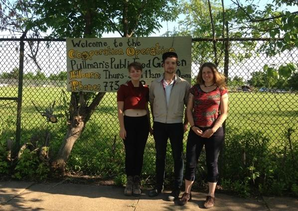Erin Delaney (from left) Justin Booz and Liz Nerat outside the community garden in Pullman.