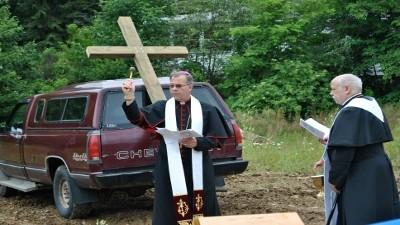 Bishop John E. Mack spreads Holy Water to bless the construction site of the new Holy Cross Church along Mount Airy Drive in Richland Township.