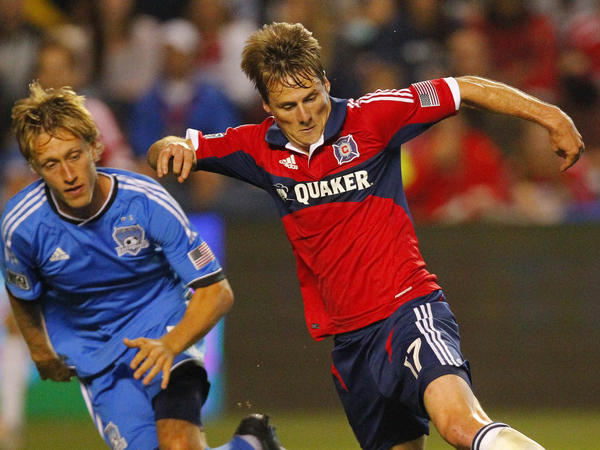 Fire forward Chris Rolfe (right) passes San Jose Earthquakes midfielder Brad Ring during a game this month.
