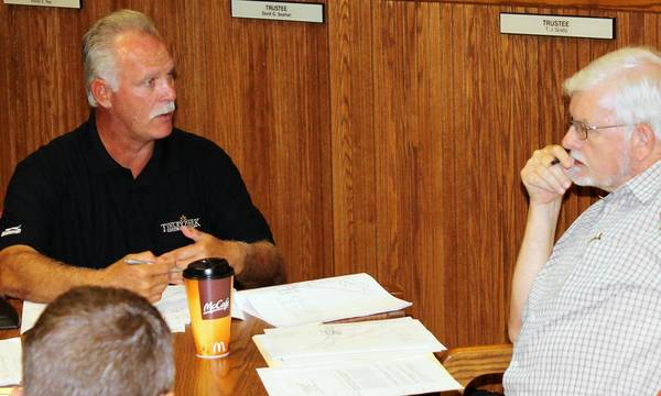 Tinley Park Park District Director John Curran, left, and Village Plan Commissioner Bill Reidy discuss landscaping plans for a proposed dog park prior to a July 18 meeting of a citizen advisory panel.