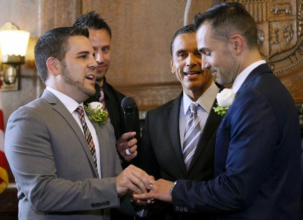 Burbank residents Jeff Zarillo and Paul Katami, right, during their wedding ceremony officiated by L.A. Mayor Antonio Villaraigosa, center, at City Hall in Los Angeles on June 28.