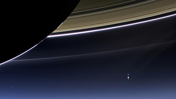 Earth appears as a pale blue speck beneath Saturn's rings in this image taken by NASA's Cassini s
