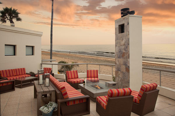 The patio at the Sandcastle Inn in Pismo Beach, one of 15 California hotels having a sale in honor of the royal birth.