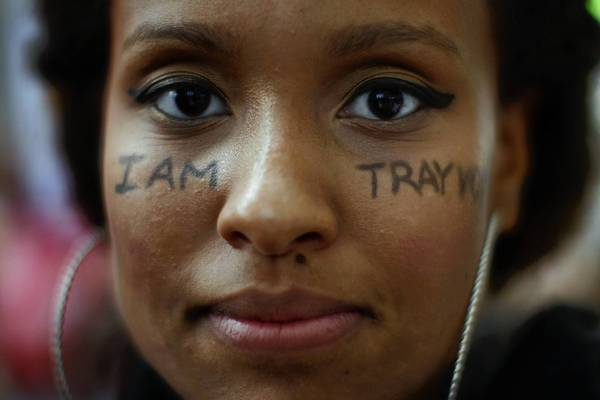 A message on a Los Angeles protester's face Saturday displays her support for Trayvon Martin, who was shot and killed by George Zimmerman last year.