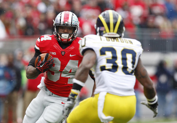 Ohio State running back Carlos Hyde runs toward Michigan safety Thomas Gordon during a game Nov. 24. (MCT Photo)