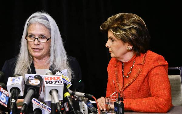Attorney Gloria Allred, right, listens as client Irene McCormack Jackson announces a sexual harassment lawsuit against San Diego Mayor Bob Filner. Jackson had been the 70-year-old Democrat's director of communications.