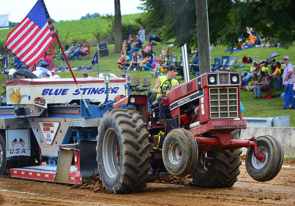 Nicholas Baker of Boonsboro scored a distance of 323.86 feet Monday in the youth tractor pull Monday at the Washington County Ag Expo & Fair.