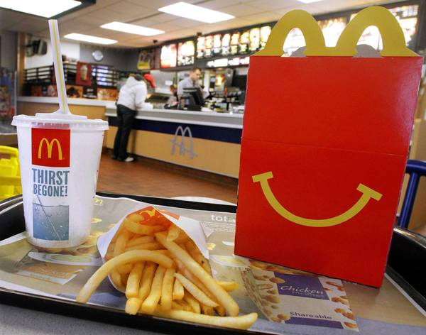McDonald's reported second-quarter net income of $1.4 billion, or $1.38 a share. Analysts surveyed by Thomson Reuters had expected $1.40 a share. Above, a McDonald's restaurant in Springfield, Ill.