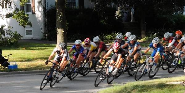 Racers round a curve at the Elmhurst Cycling Classic.