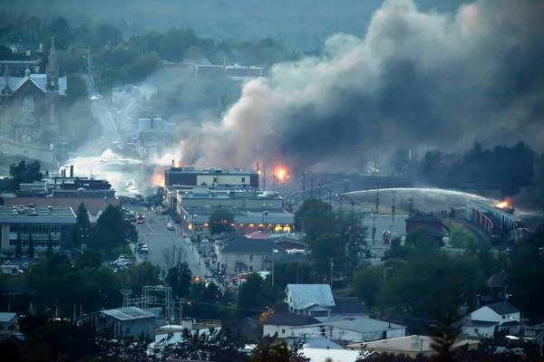 Firefighters douse blazes after a freight train loaded with oil derailed in Lac-Megantic in Canada's Quebec province on July 6
