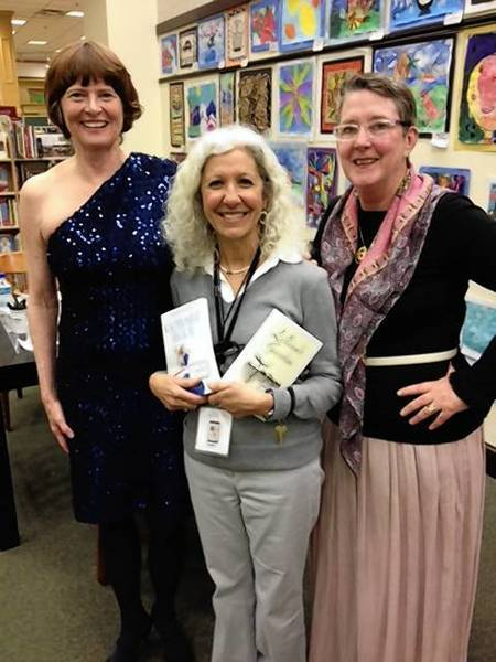 Peggy Payne (left) and Carrie Jane Knowles (right) at book signing with fan at a Barnes and Noble store.