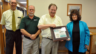 Borough President honors Somerset Trust with an Award for their various national accomplishments. Pictured from left to right: Dan Mickey, main office manager; Hank Parke, community relations officer; Henry Cook, president; and Ruby Miller, borough president