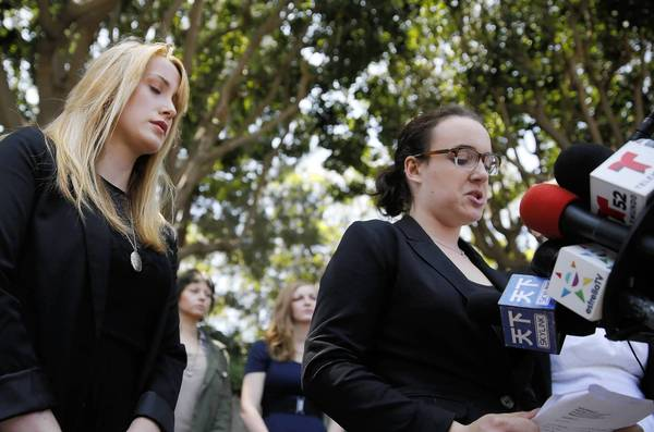 Tucker Reed, left, and Ariella Mostov, USC students who object to the university's handling of their reports of sexual assault, appear at a news conference Monday.