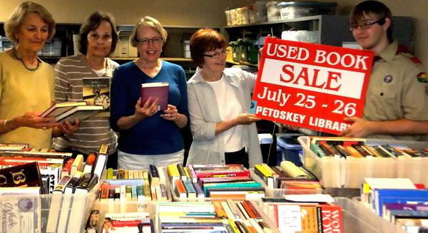 The Friends of the Petoskey Library will sell hundreds of quality used books, donated by community members, at its annual used book sale on Thursday and Friday, July 25-26. This year the Friends has received assistance from Eagle Scout candidate Travis Johnson, who helped collect books at the June 8 book drive. Members of the used book committe include (from left) Jane Damschroder, Peg Pinho, Joyce Hutto-Nolan, Ann Barfknecht and Travis Johnson.
