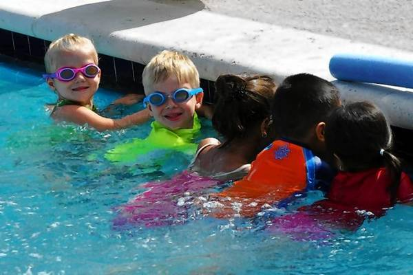 Goggle-clad little swimmers enjoy a dip in the Sims Pool on a hot summer day.