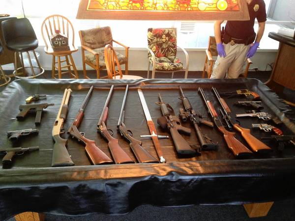 More than one dozen guns seized by MBI agents during raids in the Taft area Tuesday.