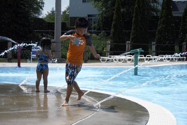 Alex Bozarth, 7, of Northbrook, plays with water at the Meadhowill Aquatic Center in Northbrook on July 18.
