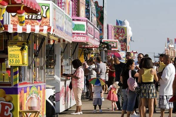 Crowds meander on the midway at last year's Lake County Fair.