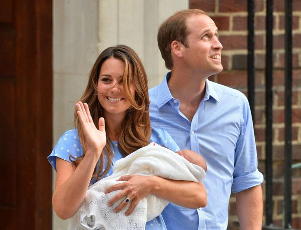 Prince William and Catherine, Duchess of Cambridge show their new-born baby boy to the world's media, on the steps outside the Lindo Wing of St Mary's Hospital in London on July 23, 2013. The baby was born on Monday afternoon weighing eight pounds six ounces (3.8 kilogrammes). The baby, titled His Royal Highness, Prince (name) of Cambridge, is directly in line to inherit the throne after Charles, Queen Elizabeth II's eldest son and heir, and his eldest son William. AFP PHOTO / BEN STANSALLBEN STANSALL/AFP/Getty Images ORG XMIT:
