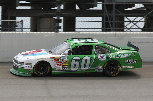 Travis Pastrana, driver of the #60 Valvoline NextGen Ford, races during the STP NASCAR Nationwide Series race at Chicagoland Speedway on July 21, 2013 in Joliet, Illinois.
