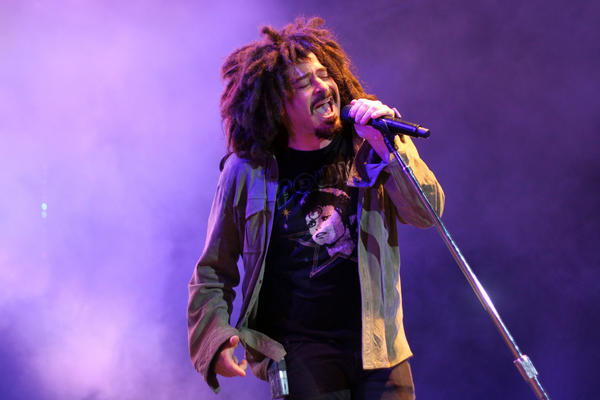 "Adam Duritz of the Counting Crows sings the band's hit single ""Mr. Jones"" Sunday."
