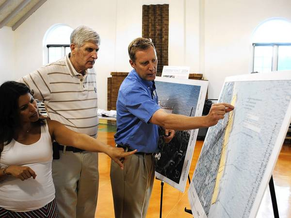 Park District of Highland Park Director of Planning and Projects Rick Stumpf, right, points out some components of an upcoming Rosewood Beach plan at a July 16 open house.