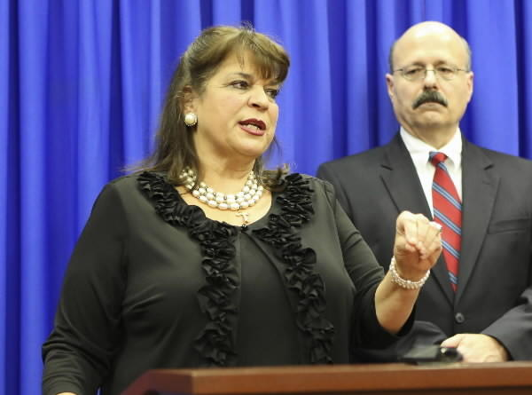 Florida State Attorney Angela Corey and assistant state attorney Bernie de la Rionda address the media after a jury found George Zimmerman not guilty in Seminole circuit court July 13, 2013 in Sanford, Florida.