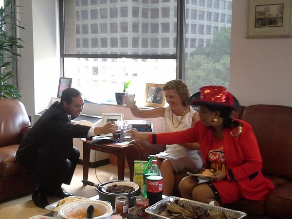 U.S. Reps. Joaquin Castro, Debbie Wasserman Schultz (center) and Frederica Wilson eat Tex-Mex food to pay off the bet between Wasserman Schultz and Castro over the Heat and Spurs in the NBA Finals.