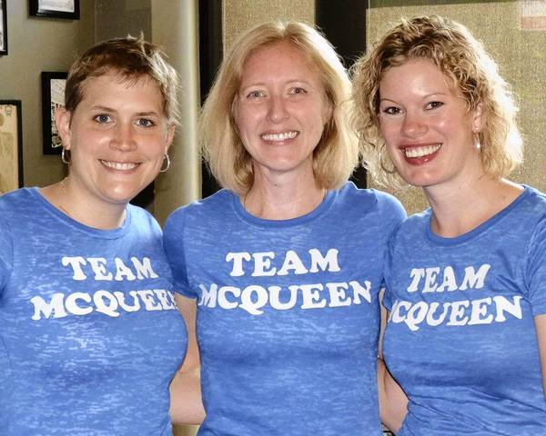 Kristin McQueen, center, poses at a fundraiser to raise money for the American Cancer Society. Her friends Emily Phillips, left, and Tracy Jensen, right, have helped her raise money and create a video to enter a contest for a spot at the Hawaii Ironman.