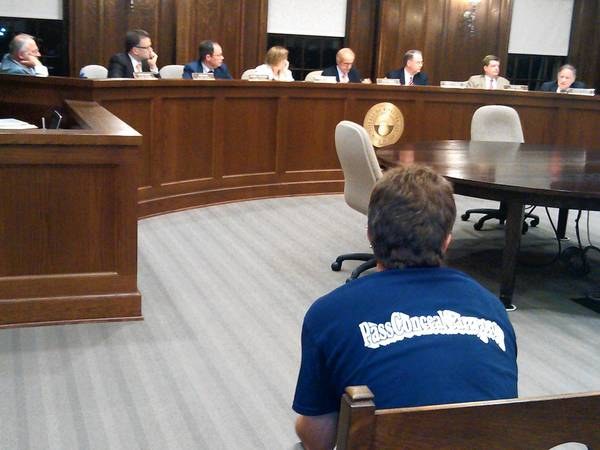 Wearing a t-shirt in support of the conceal carry law, Round Lake resident Scott Szczesny looks on as the Winnetka Village Council discusses new regulations on assault weapons.