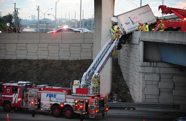 Fort Lauderdale Fire Rescue work the scene of a Feb. 6 crash on a State Road 84 overpass at I-95.
