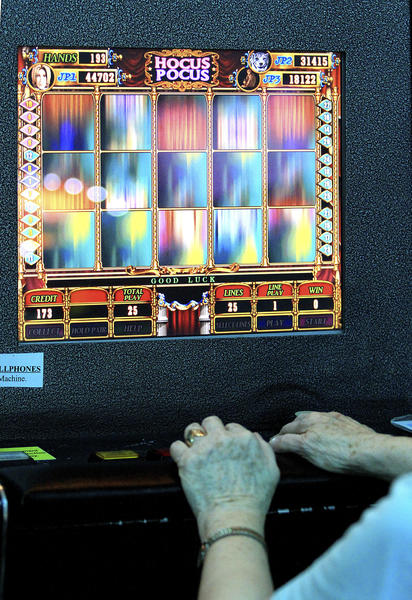 In March, an unidentified woman played on a gaming machine at Atlantic Games in Delray Beach.