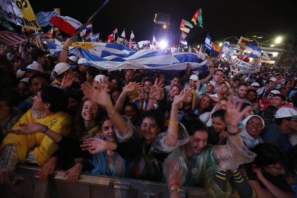 Thousands of young people gather Tuesday on Copacabana Beach for a World Youth Day Mass in Rio de Janeiro.