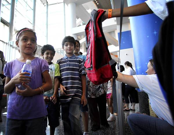 Kids like up to get free backpacks during the 2011 Back To School Bash by Hope Now International at the Amway Center on August 13, 2011.