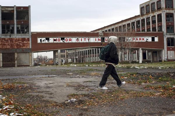 Detroit filed for Chapter 9 bankruptcy protection. Above: A person walks past the remains of the Packard Motor Car Company.