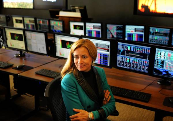 JPMorgan has been accused of serial frauds against California utility customers. Blythe Masters, above in a Denver office, is a bank commodities executive.