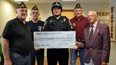 The American Legion Post 181 and the Veterans of Foreign Wars Post 554 made donations to Somerset Borough for the purchase of police motorcycles. The donations, totaling $12,500, were presented during the Somerset Borough Council meeting on Monday. Pictured with the legion members are: Carl Brown, legion commander; Vern Miller, legion board member; Jordan Shaulis, borough police officer; Robert Becker, legion member; and Mayor William Meyer.