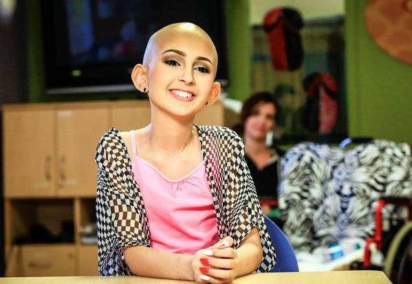 Talia Castellano, a 13-year-old internet sensation who battled brain cancer, films an interview with a local film crew at Arnold Palmer hospital in Orlando on May 08, 2013.