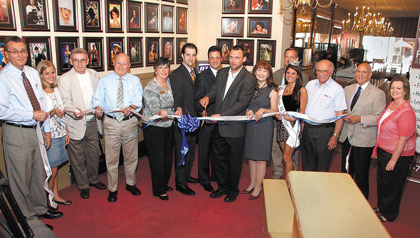 From left, City Administrator Bruce Zimmerman; picture framer Bill Davis and granddaughter; Hagerstown City Councilman Don Munson; Julianna Albowicz, representative from the office of U.S. Sen. Barbara Mikulski; Sonny Holdings, representative from the office of U.S. Rep. John Delaney; Benito Vattelana, president of The Maryland Theatre; Hagerstown Mayor David Gysberts; Sherry Rush, executive director of The Miss Maryland Scholarship Pageant; Miss Maryland 2012 Johanna Guy; Tom Riford, president of the Hagerstown-Washington County Convention and Visitors Bureau, Photography By Dale's Dale Swope; Maryland Theatre Facilities Chairman Ron Bowers; and Photography By Dale's Mary Pat Kelley cut the ribbon on the new Miss Maryland Photo Gallery at The Maryland Theatre.