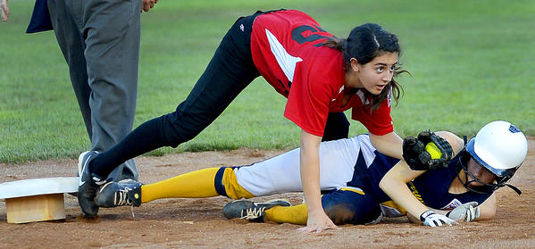 Perryville runner Erin Murphy, bottom right, is out at second base as South Maryland infielder Abby Wilson, center, applies the tag in the fourth inning of Tuesday's Maryland State Junior Softball Tournament game at Sharpsburg Little League.