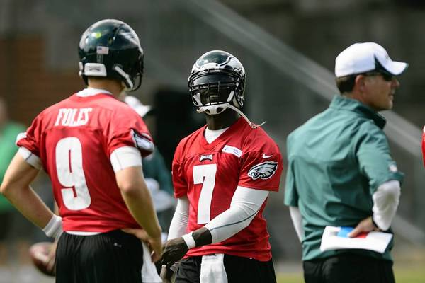 Jul 23, 2013; Philadelphia, PA, USA; Philadelphia Eagles quarterback Michael Vick (7) and quarterback Nick Foles (9) during training camp at the Eagles NovaCare Complex.