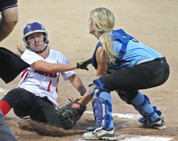 Crescenta Valley-Foothill catcher Camie Ellingford tags out a Westchester Del Rey runner at home in a 12-0 loss.