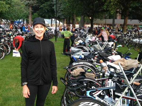 Dana Locken stands next to her bike as she gets ready to start a 112-mile bike ride for an Ironman competition earlier this summer.